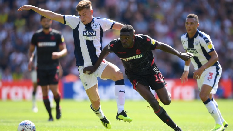 West Brom's Harvey Barnes battles for the ball against Bolton