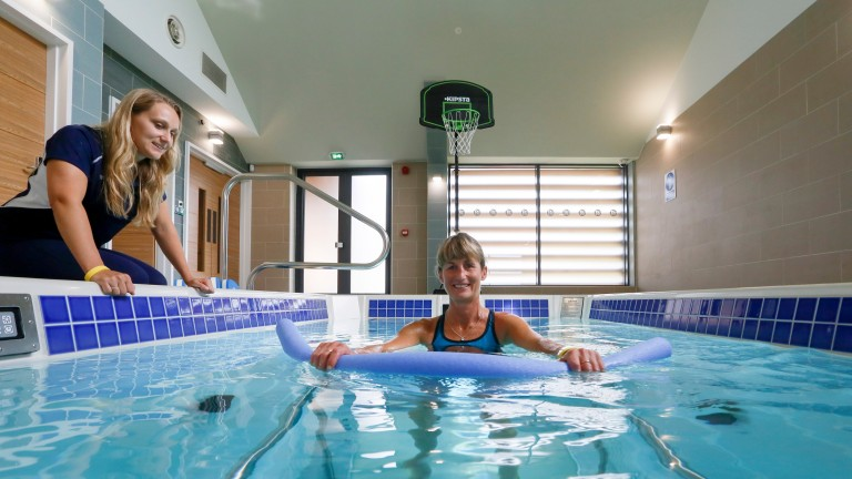 Jo Foster in the pool at Jack Berry House with physiotherapist Gemma Darley