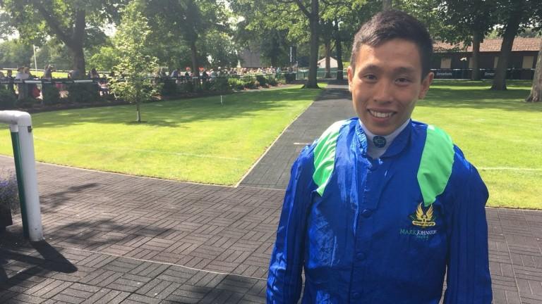 Vincent Ho: Hong Kong jockey wins on first ride in Britain at Haydock