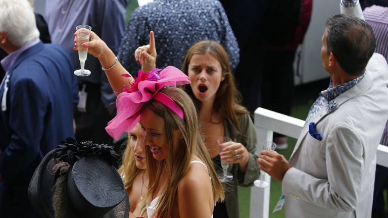 Time to collect: racegoers celebrate a winner