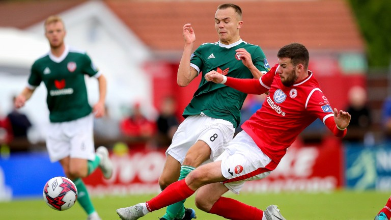 Sligo's Patrick McClean tackles Derry City's Rory Hale