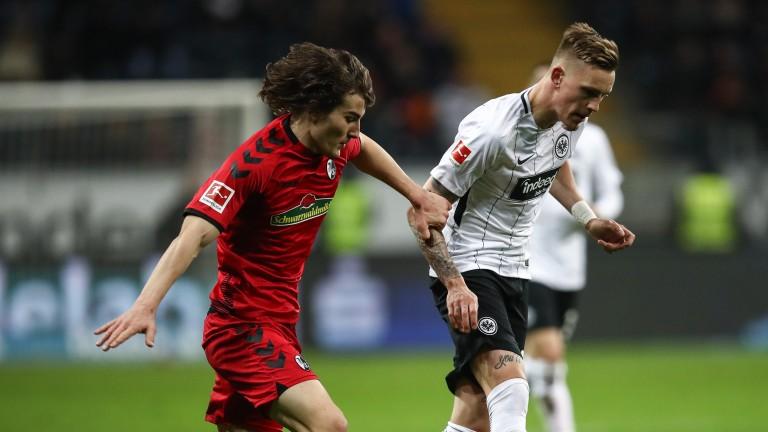 Caglar Soyuncu (left) playing for SC Freiburg
