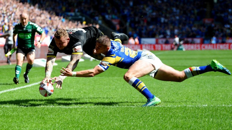 Leeds concede a try to Josh Charnley during last week's cup thrashing by Warrington