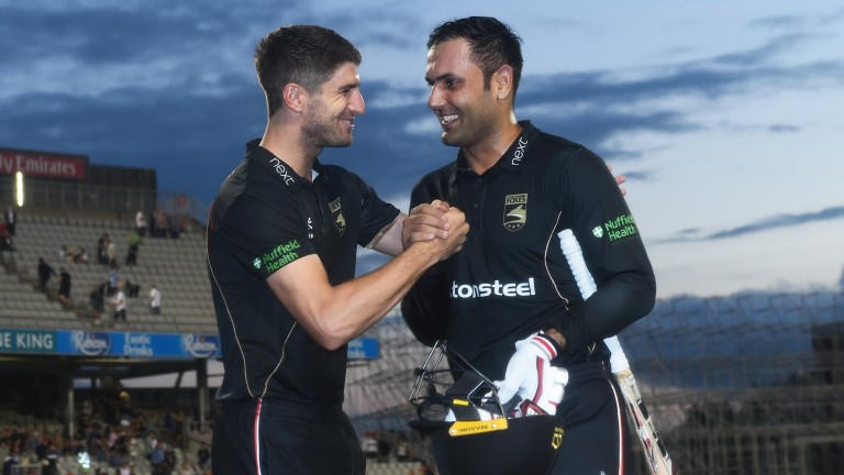 Colin Ackermann and Mohammad Nabi celebrate Leicestershire's win at Old Trafford