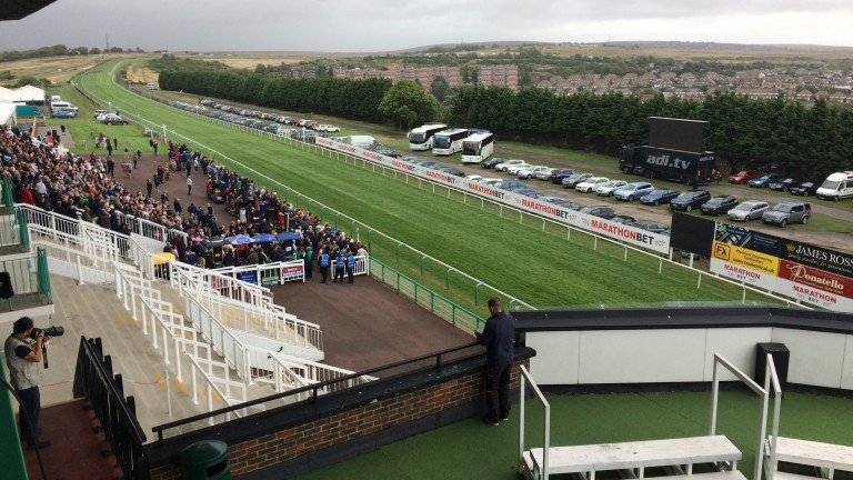 The scene at Brighton after officials made the decision to evacuate the Premier Enclosure.