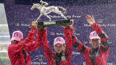 ASCOT, ENGLAND - AUGUST 11:  Jockeys, L-R, Josephine Gordon, Hollie Doyle and Hayley Turner hold the Shergar Cup aloft at Ascot Racecourse on Shergar Cup Day on August 11, 2018 in Ascot, United Kingdom. (Photo by Alan Crowhurst/Getty Images)