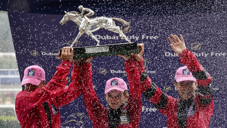 Champions: the Girls team are sprayed in champagne as they celebrate winning the Shergar Cup