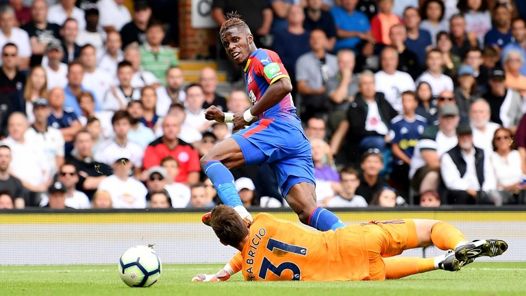 Wilfried Zaha of Crystal Palace scores past Fabricio Agosto Ramirez of Fulham