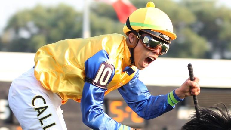 Celebration time: winning jockey Irad Ortiz enjoys the moment as Robert Bruce wins the Arlington Million