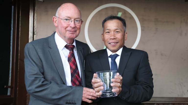 Mike Harbridge judged the best turned out award and presented the prize for the third race at Haydock