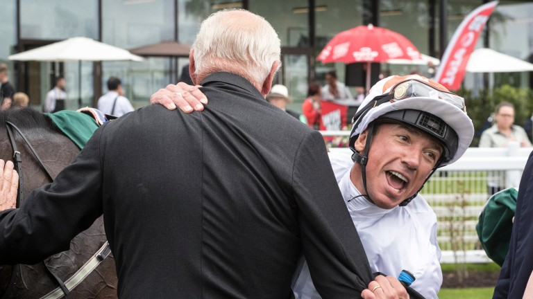 Frankie Dettori hugs Martyn Meade after victory for Advertise in the Phoenix Stakes