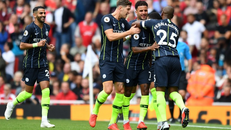 Manchester Ciity celebrate Raheem Sterling's opener at Arsenal
