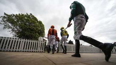 YORK, ENGLAND - MAY 16: A general view as jockeys leave the weighing room at York Racecourse on May 16, 2018 in York, United Kingdom. (Photo by Alan Crowhurst/Getty Images)