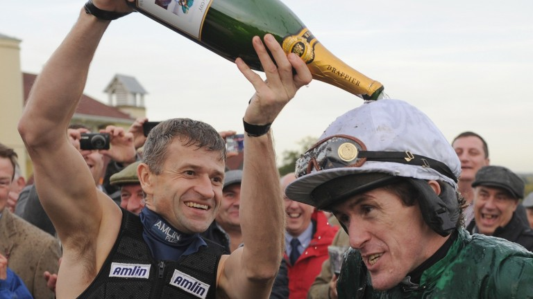 Andrew Thornton drenches Sir Anthony McCoy with champagne