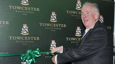 Racecourse Chairman and owner Lord Hesketh cuts the ribbon to officially launch Towcester Greyhound track.13th December 2014.Photo: Steve Nash