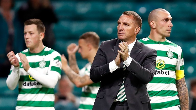 Celtic manager Brendan Rodgers applauds the fans