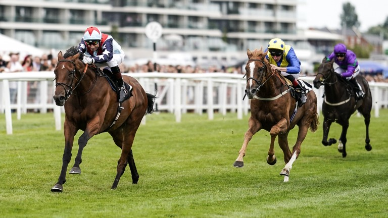 Sir Dancealot and Gerald Mosse come clear in the Hungerford Stakes
