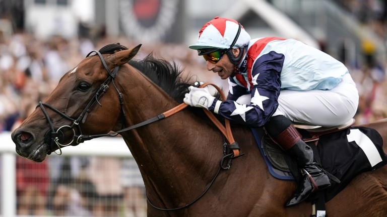 Smile: Gerald Mosse's delight is evident as he scores aboard Sir Dancealot