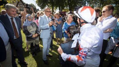 Amer Abdulaziz of Phoenix Thoroughbreds takes a photo of his daughter with Frankie Dettori ahead of the Darley Prix Morny.Deauville.Photo: Patrick McCann/Racing Post 19.08.2018
