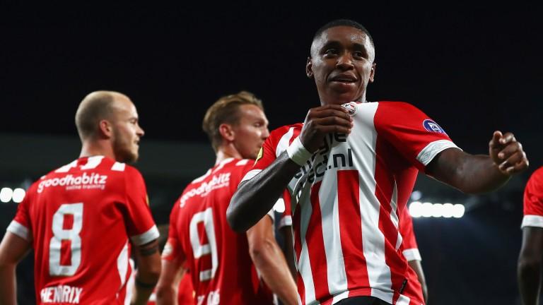 Steven Bergwijn of PSV celebrates scoring against Utrecht