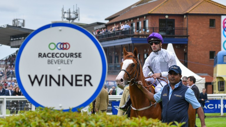Chica La Habana and Adam Beschizza reteurn to the winners' enclosure at Beverley