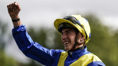 James Doyle celebrates victory after riding Poet's Word to win the King George at Ascot