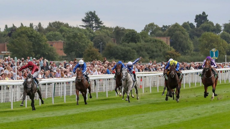Lion King: Roaring Lion (left) draws clear to register an impressive success in the Juddmonte International