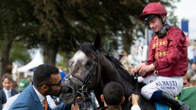 Sealed with a kiss: owner Sheikh Fahad is on hand to greet Roaring Lion in the winner's enclosure