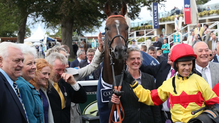 Graham Lee (yellow) surrounded by connections after winning his first Nunthorpe