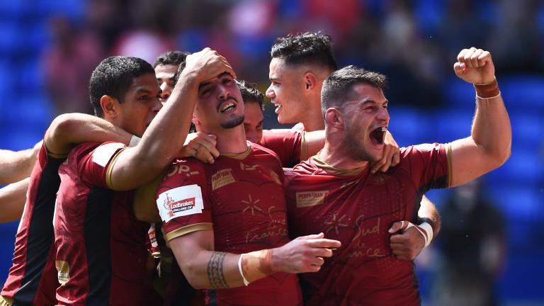Tony Gigot of Catalans Dragons celebrates with his team mates