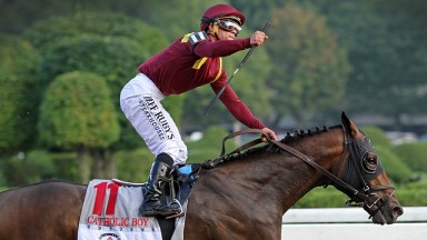 Javier Castellano punches the air as he wins the Grade 1 Travers Stakes on Catholic Boy at Saratoga