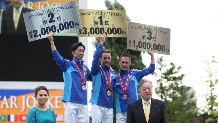 Christophe Lemaire (centre) celebrates winning the World All-Star jockeys' title alongside teammates Yutaka Take (left) and Mirco Demuro