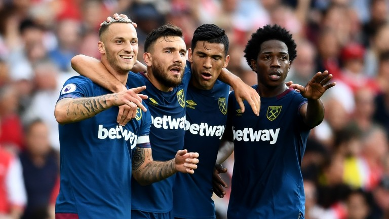 West Ham players celebrate Marko Arnautovic's goal at Arsenal