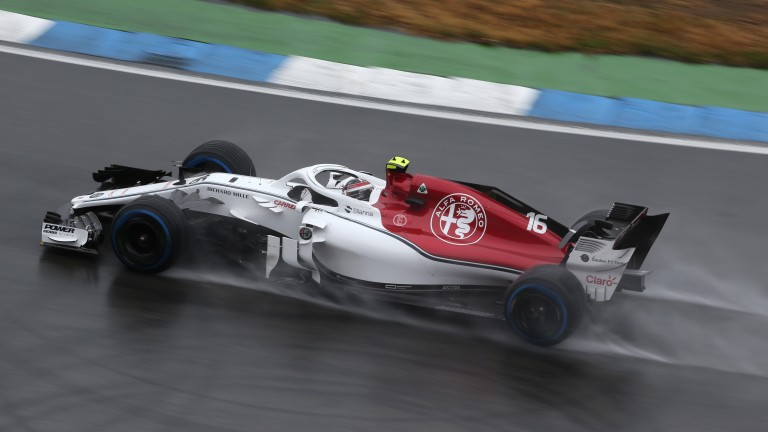 Charles Leclerc splashes through the rain in practice in Germany
