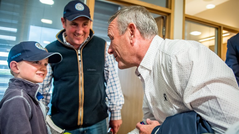 The Hong Kong Jockey Club's Mark Richards (right) greets Hillwood Stud's Charlie Vigors and son Harry