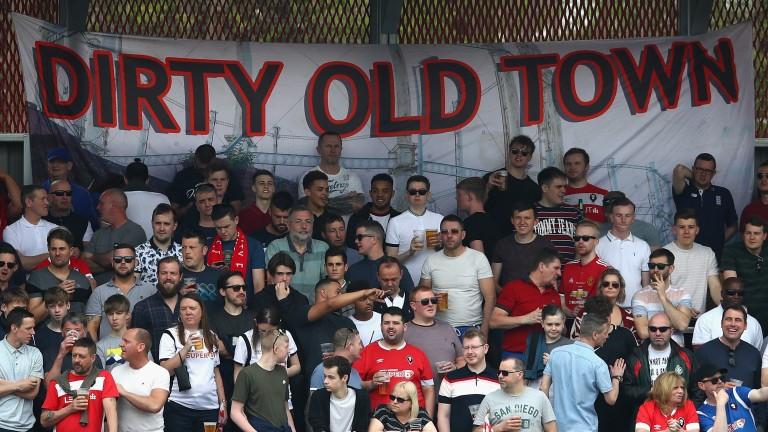 Salford City fans cheer their team