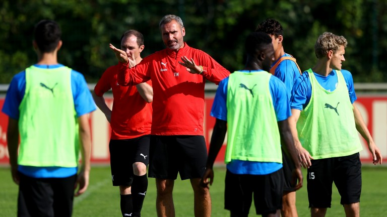 Holstein Kiel head coach Tim Walter gives instructions during a training session