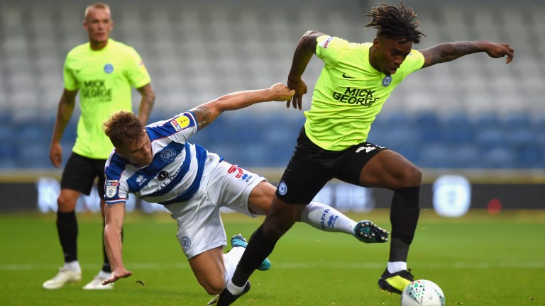 Peterborough's Ivan Toney evades a tackle from a QPR defender
