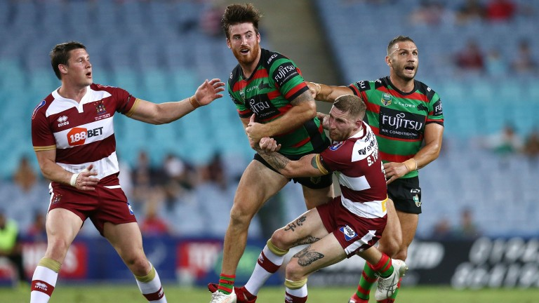 Wigan full-back Sam Tomkins (second from right) is expected to be fit to face Wakefield