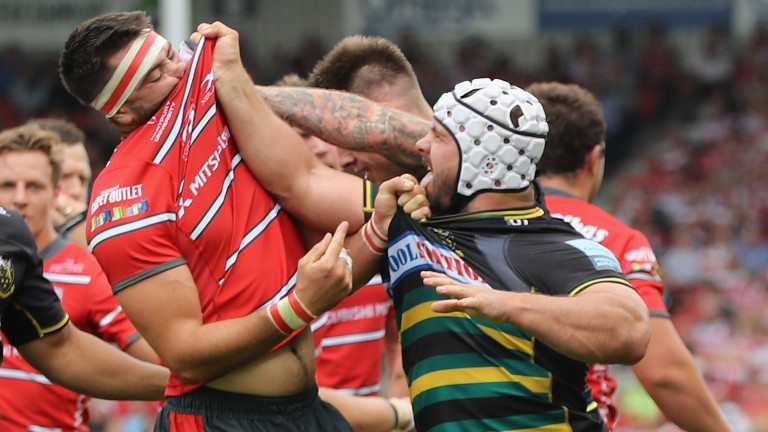 Heinrich Brussow (right) of Northampton Saints tussles with Gloucester's Lewis Ludow