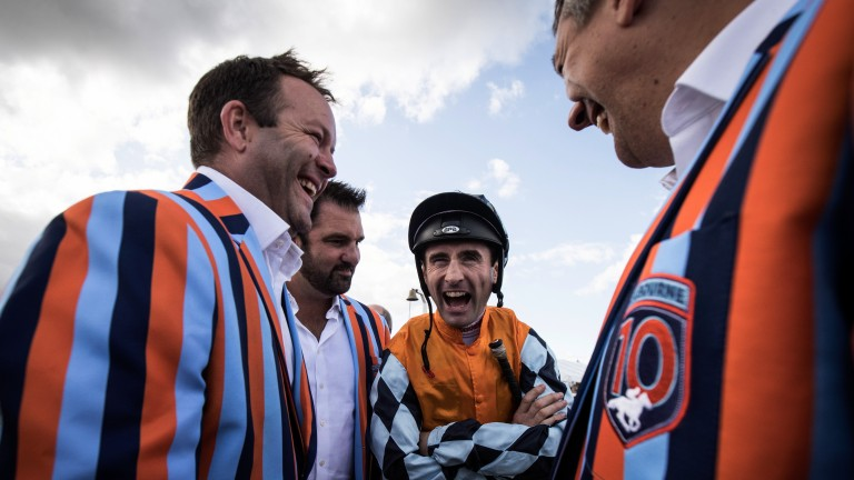 Life's a beach: Dougie Costello is greeted by the Melbourne 10 syndicate before their horse Pulsating finished second in the 7f claiming race