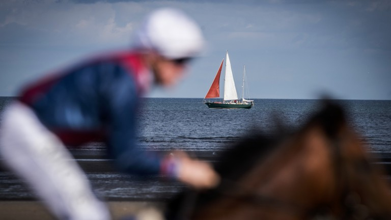 We are sailing: a runner flashes by in the opener as a boat sails in the distance