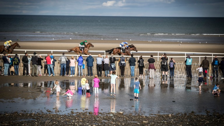 Kids playing in the puddles as Waqaas wins at Laytown