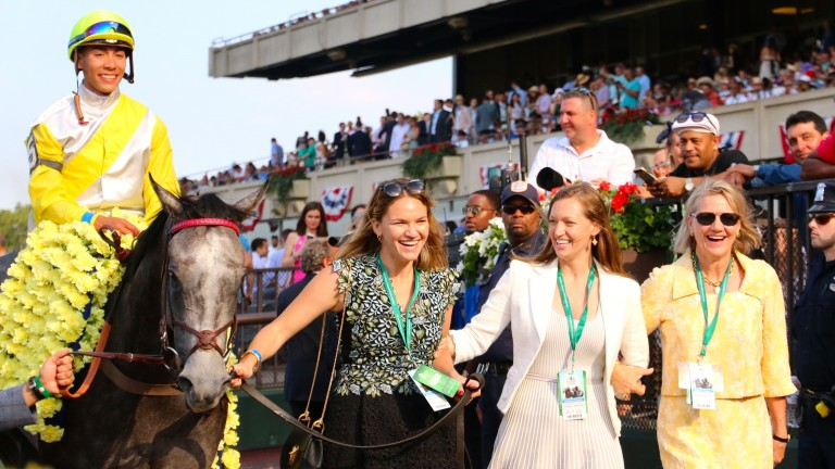 Lynn Hancock (left) leads in Ascend after the 2017 Grade 1 Manhattan Stakes, accompanied by her sister Alex and mother Staci
