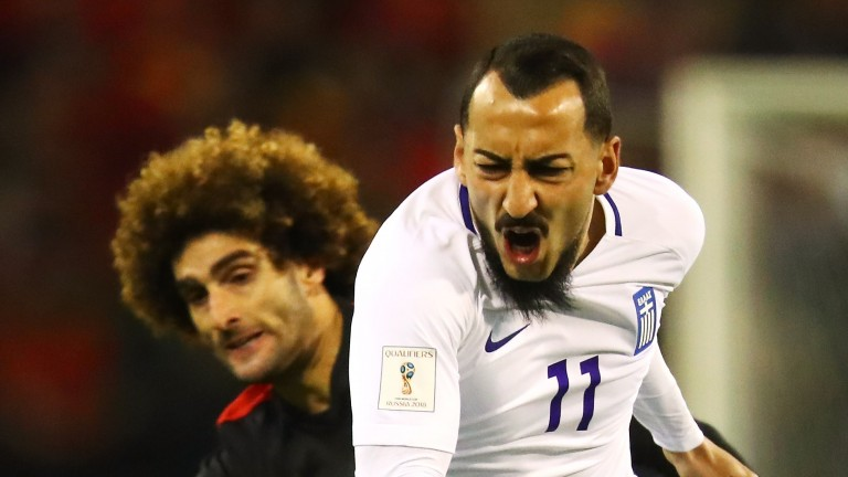 Kostas Mitroglou of Greece is fouled by Marouane Fellaini of Belgium