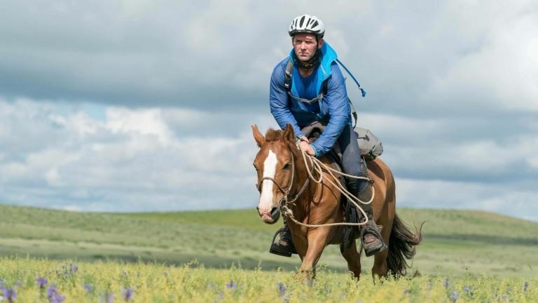 JD Moore in full flight across the Mongolian steppe