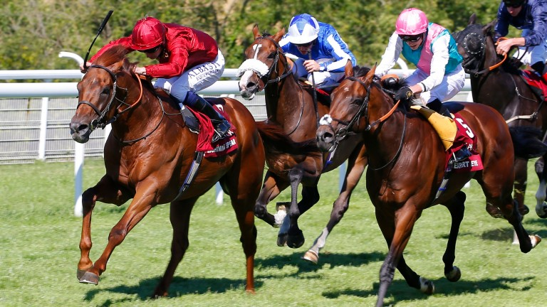 Lightning Spear comes out on top against Expert Eye (pink cap) in the Sussex Stakes last month. The pair resume rivalry at Longchamp on Sunday