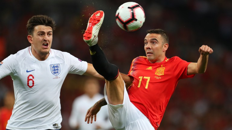 Harry Maguire of England and Iago Aspas of Spain in action