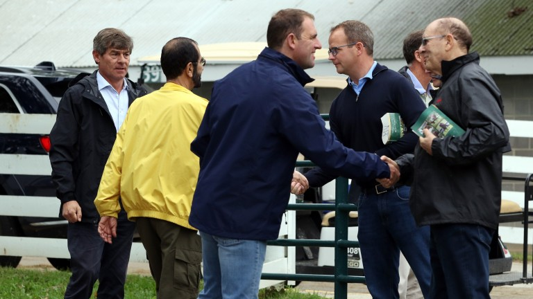 Good relations between Godolphin and Coolmore as Charlie Appleby (blue jacket) and Michael Tabor (right) shake hands, as do Sheikh Mohammed (yellow jacket) and MV Magnier (second right), as Simon Crisford (left) looks on