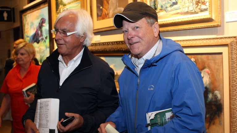Larry Best (right) after signing the docket for the $1.8 million Curlin colt